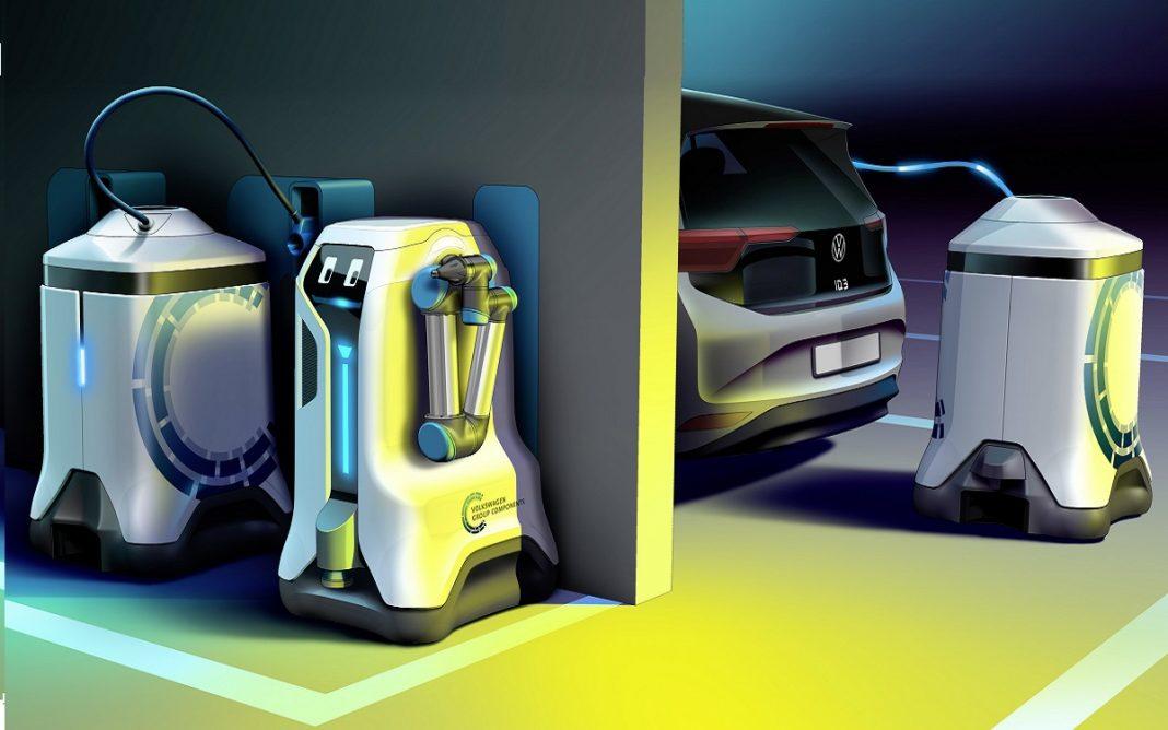 Imagen del robot de carga inteligente de VW llevando baterías a los coches