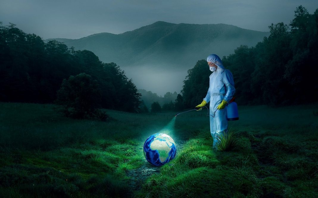 Imagen artística de una persona desinfectando el planeta